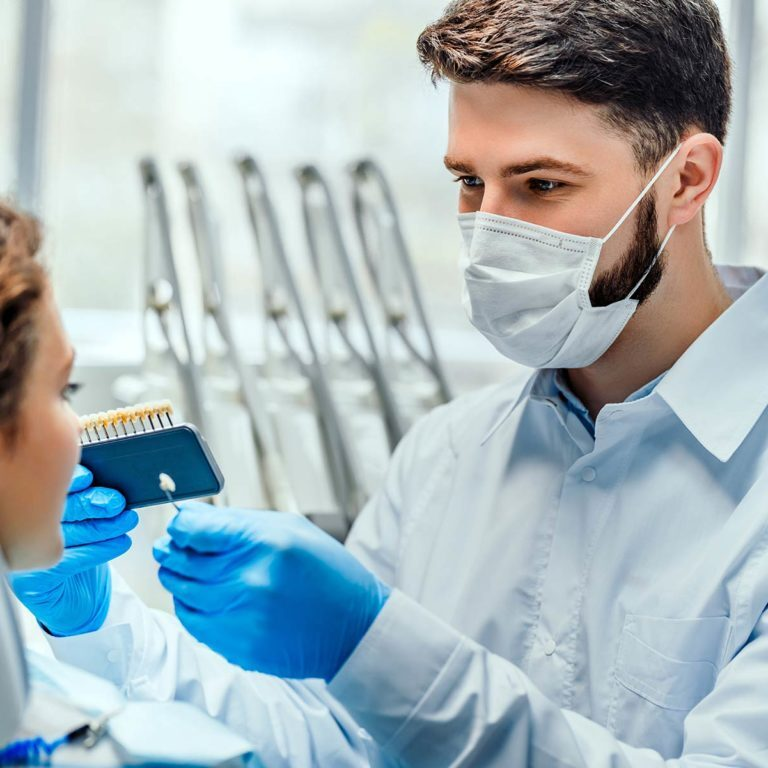 dentist matching veneer colour