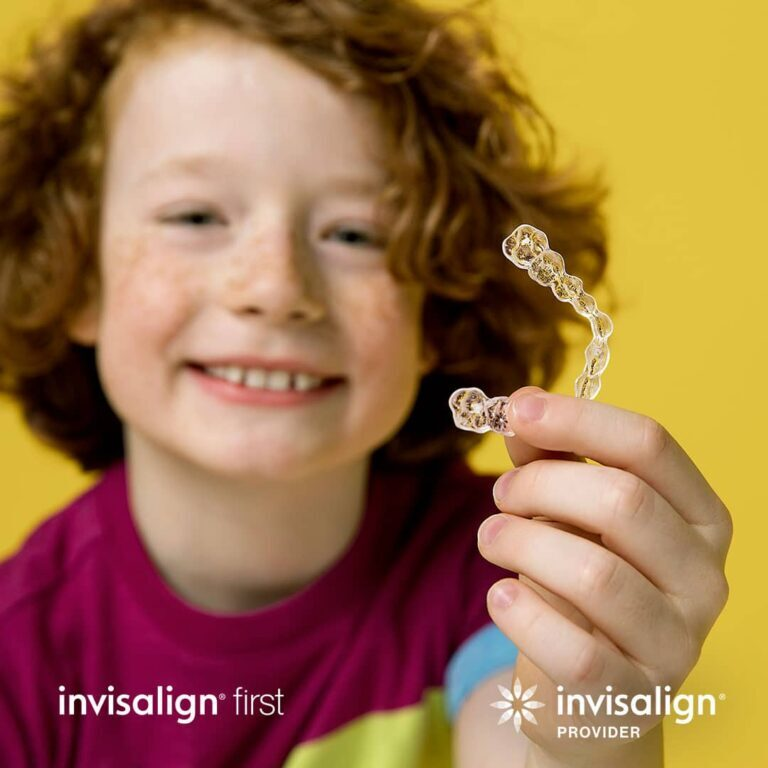 kid holding invisalign